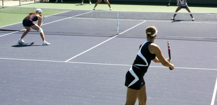 Women playing a doubles tennis match