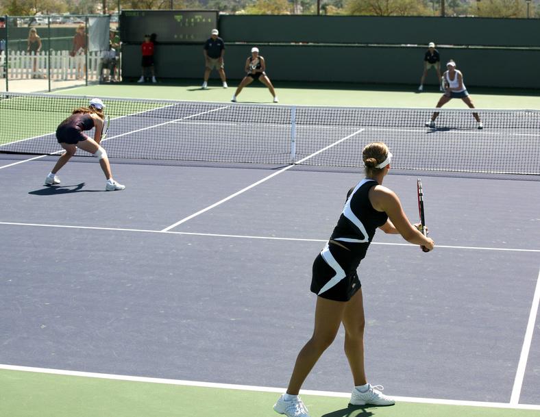 Women playing a doubles tennis match