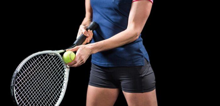 A woman holding a tennis racquet