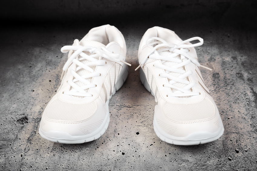 A pair of white tennis shoes