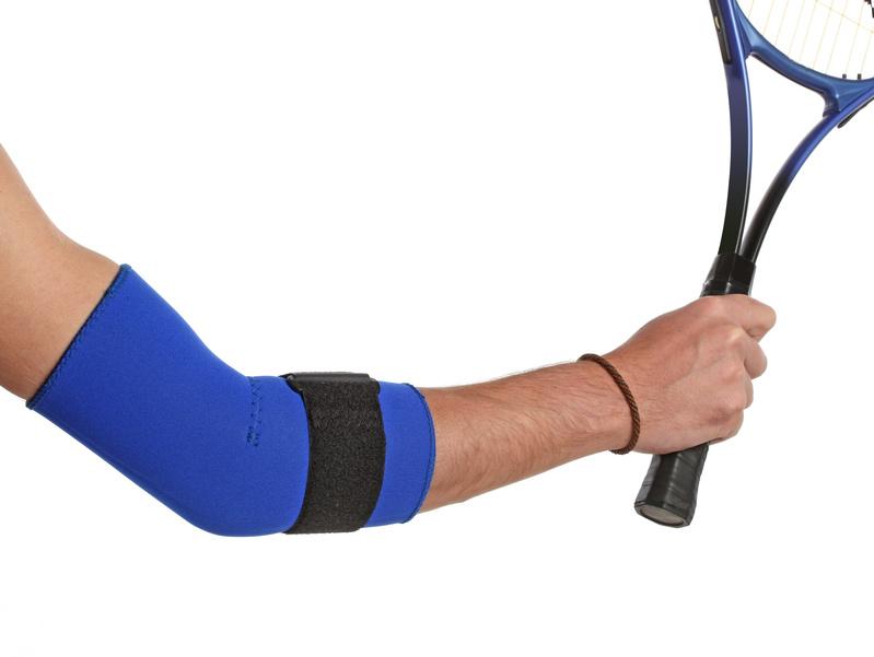 Tennis player wearing an elbow brace