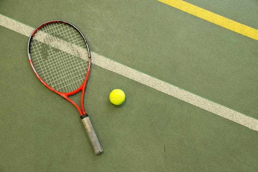 A Head tennis racquet on a court
