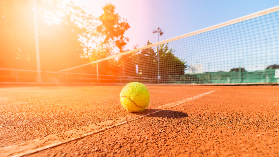 Tennis ball on a sunny court