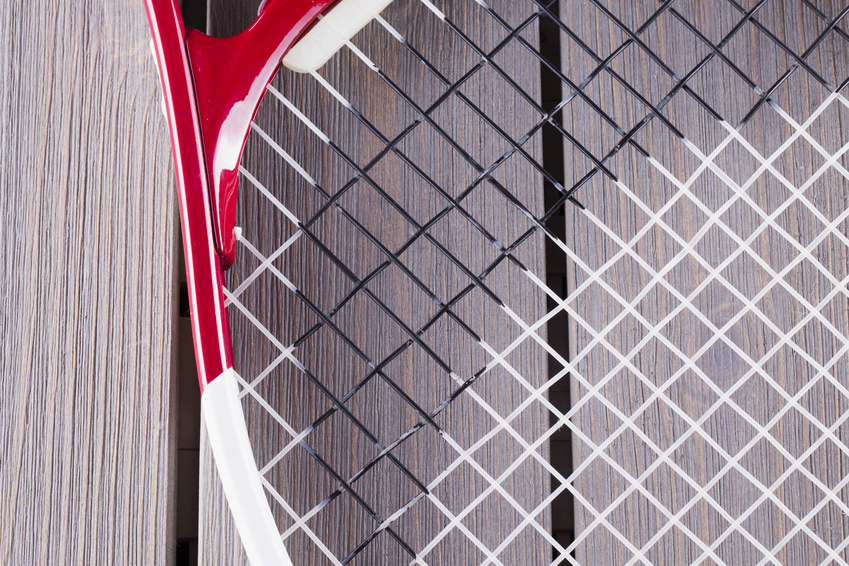 A close up of tennis racquet strings
