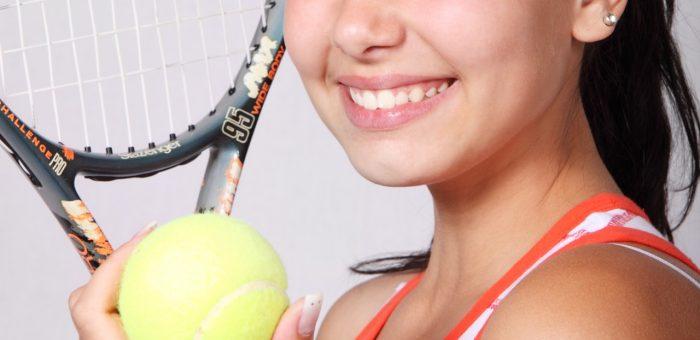 A girl holding a Slazenger tennis racquet