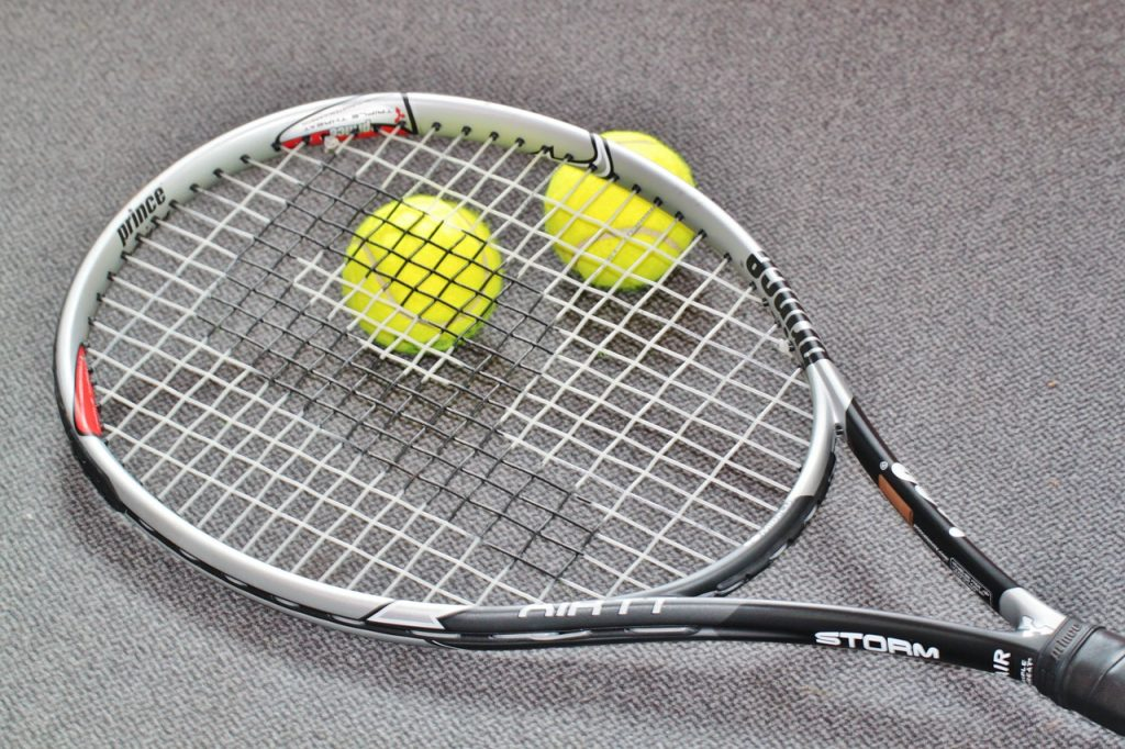 A Prince tennis racquet and two balls