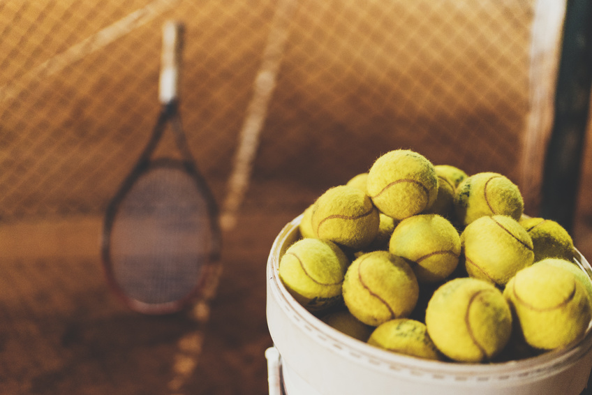 Tennis balls in a bucket