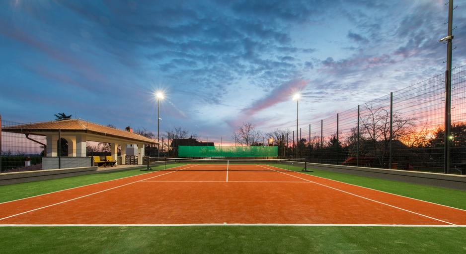 A tennis court at night