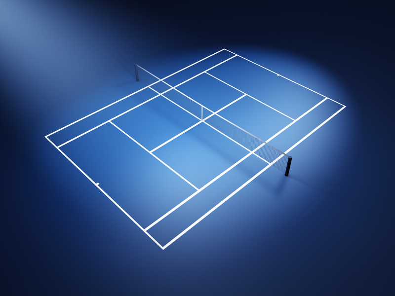 An illuminated blue tennis court