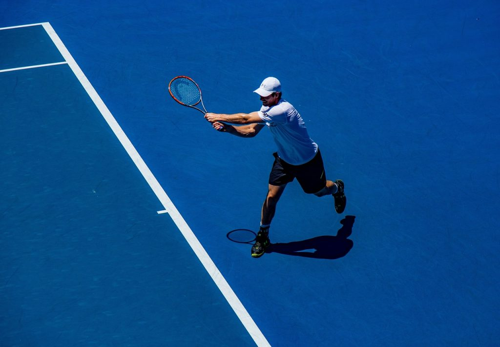 A pro tennis player man returning a shot