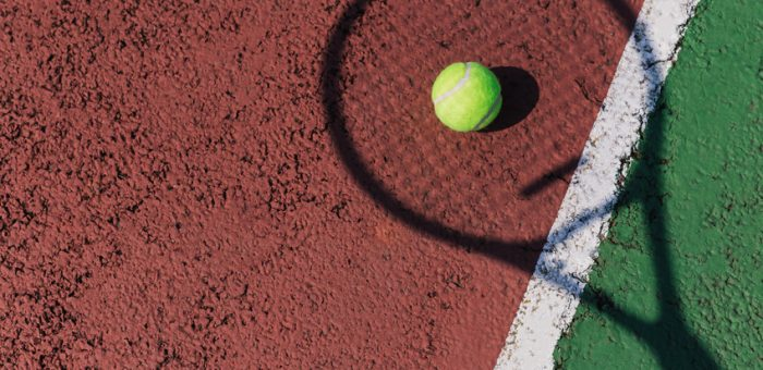 A tennis racquet shadow on a court