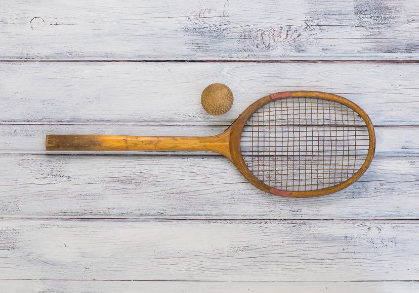 An old wooden tennis racquet