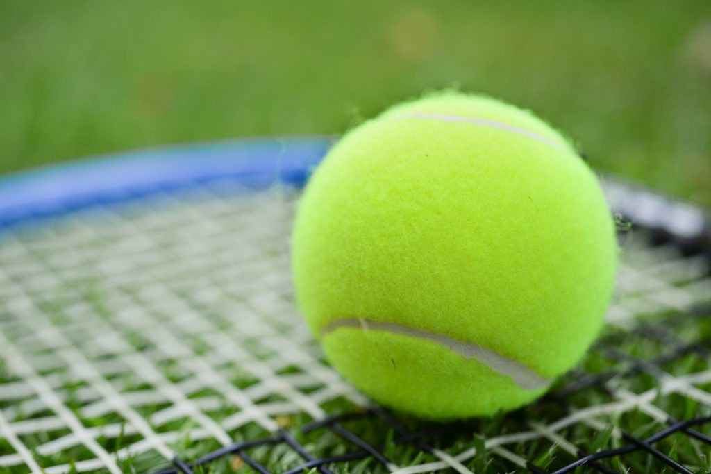 A recycled tennis ball on a racquet