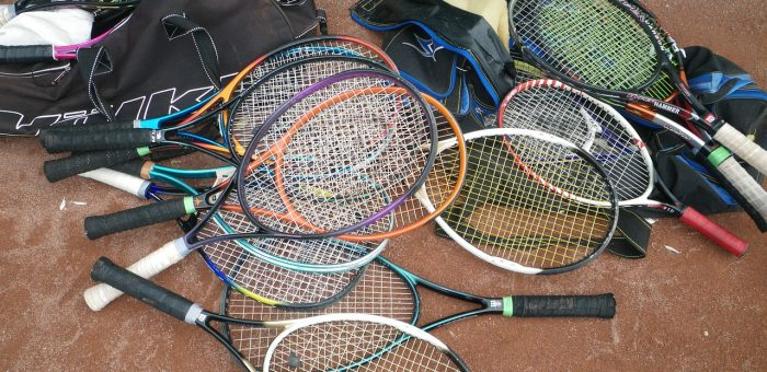A pile of old tennis rackets