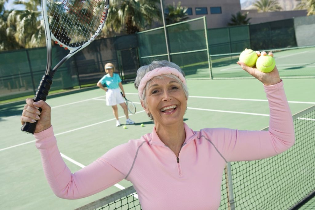 An old lady playing tennis