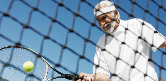 An older man playing tennis